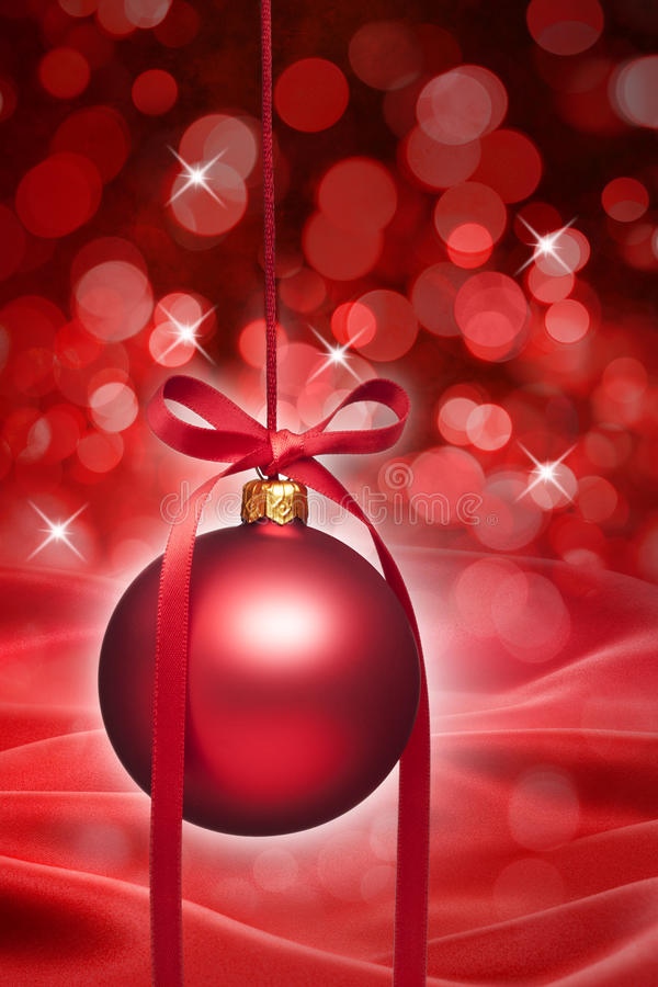 Red Christmas Ornament Background. A red Christmas ornament with a twinkly star background royalty free stock photography
