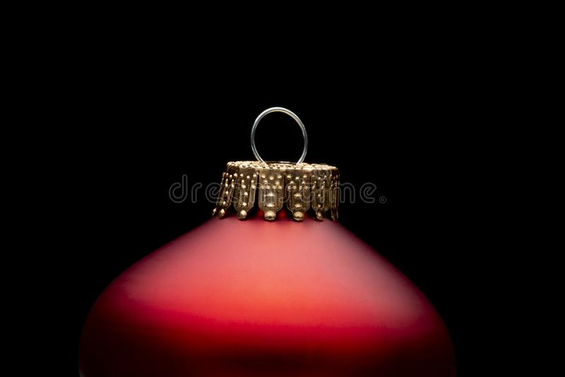 Red Christmas Ornament on a Black Background stock images