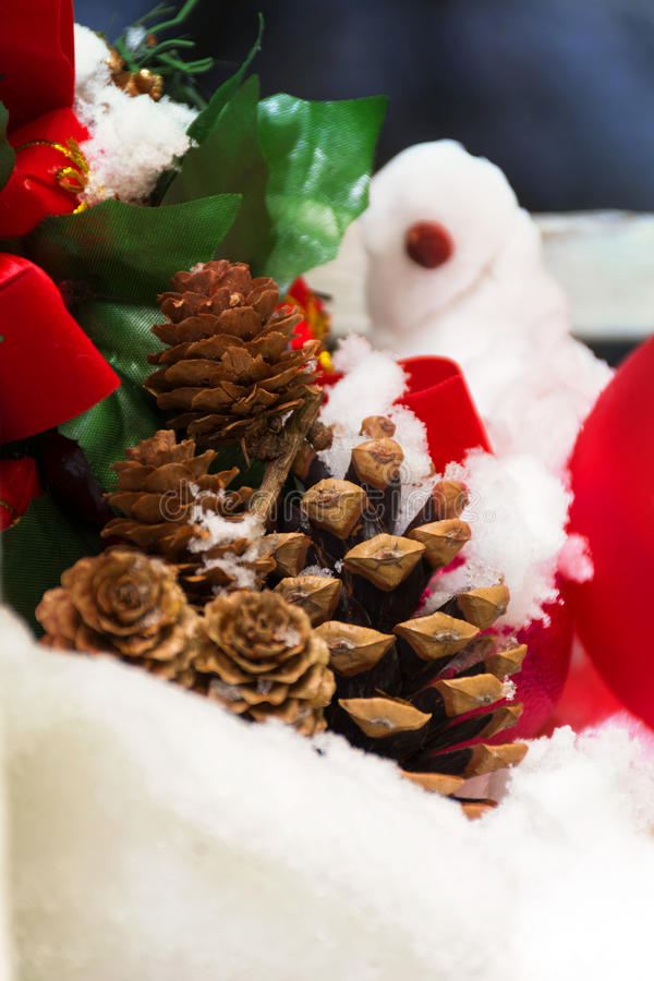 Red Christmas Ornament, snowman and Pinecones stock images