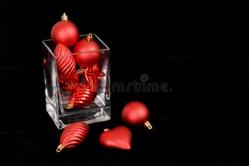 Red Christmas Ornaments In And Around A Glass Vase Stock Image