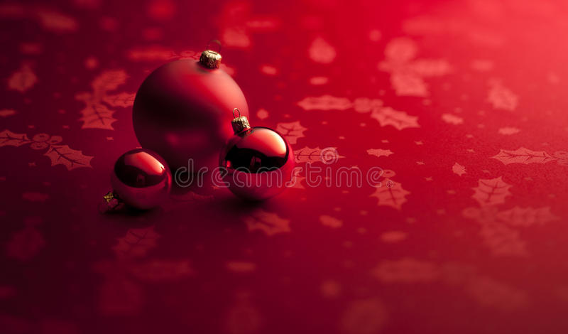 Red Christmas Ornaments Banner Background. A small still-life of red Christmas ornaments on red background banner