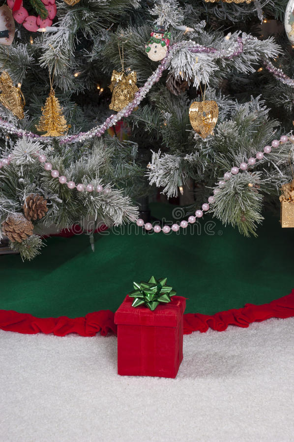 Download Red Christmas Present Gift Box By Tree Royalty Free Stock Photos - Image: 17604568