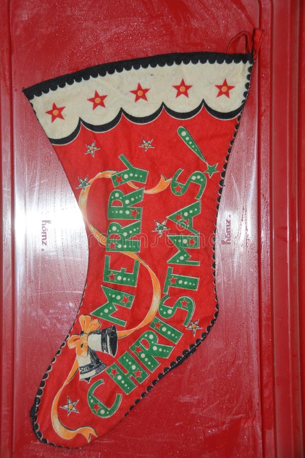 A red Christmas stocking ready for filling!. This is a traditional Christmas stocking to be hung by the fireplace with care, with the hope that Saint Nicholas stock photo
