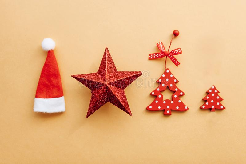 Red Christmas toys and scenery lie in a row on a yellow background. New Year or Christmas concept royalty free stock image