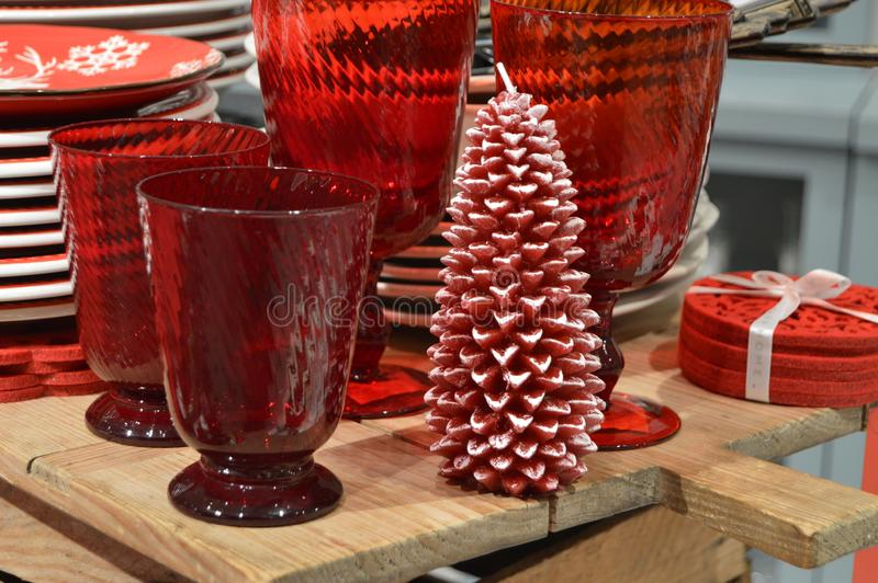 Red  christmas tree candle, red glasses and plates stock photo