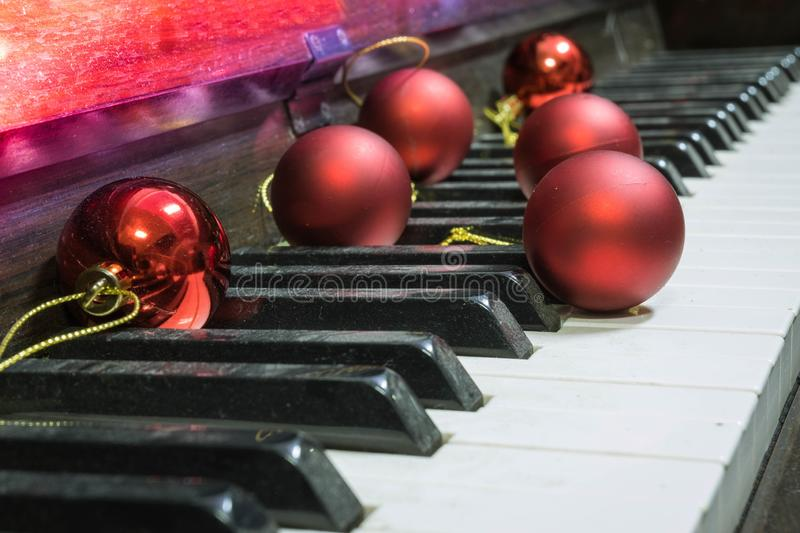 Red christmas tree decoration ball Put on the piano Make you feel Christmas or New Year`s party And celebrate the festival royalty free stock images