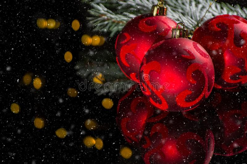 Red christmas tree decoration, red balls and green fir on black royalty free stock photos
