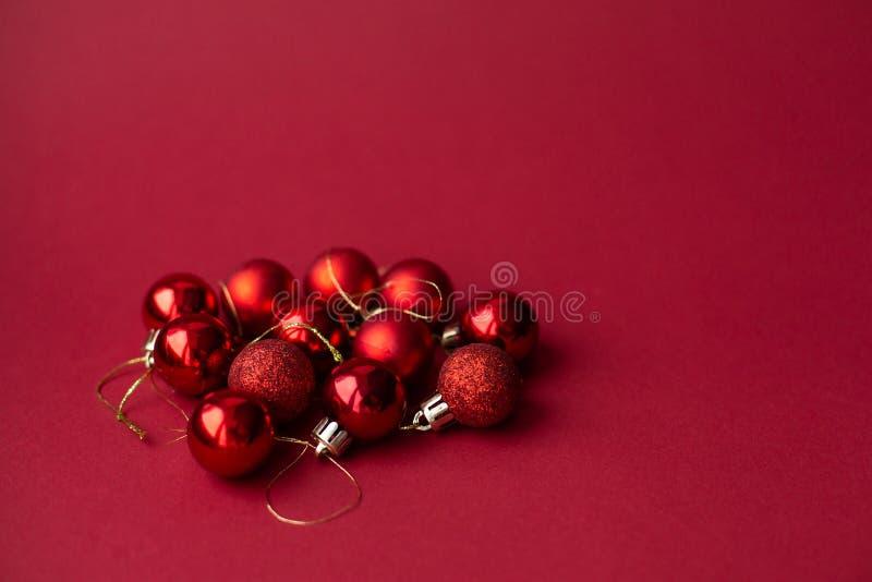 Red Christmas tree decorative toy balls on red celebratory Christmas background. New Year`s holidays. Christmas holidays.  stock photos