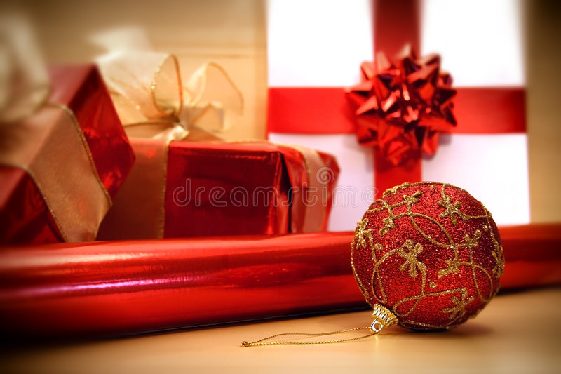 Red Christmas wrappings/ soft focus filter. Preparing to wrap Christmas gifts on a table stock photos