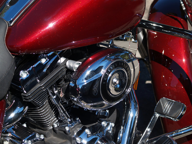 Red and chrome closeup detail of motorcycle. Red motorcycle and chrome parts detail engine and pedal royalty free stock image