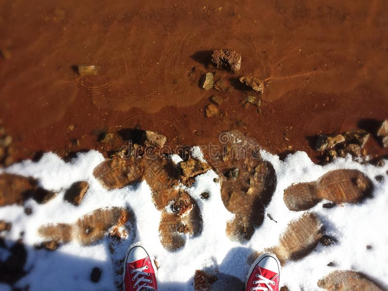 Red Chucks Red Clay. Red Chuck Taylor All-Star Converse on red clay in Tennessee during Winter stock photography