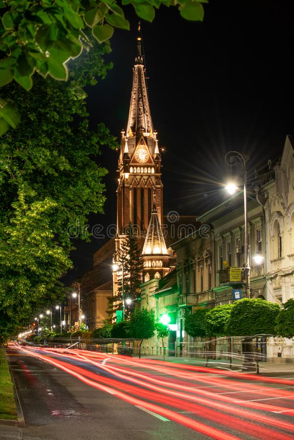 The Red Church in Arad city , old town center in the night on the summer time stock photography