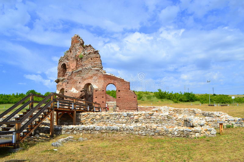 Red church Bulgaria. The Red Church restored ruins and pathway.It is the Early Medieval , early Byzantine basilica built in the V-VI century AD near Perushtitsa royalty free stock image