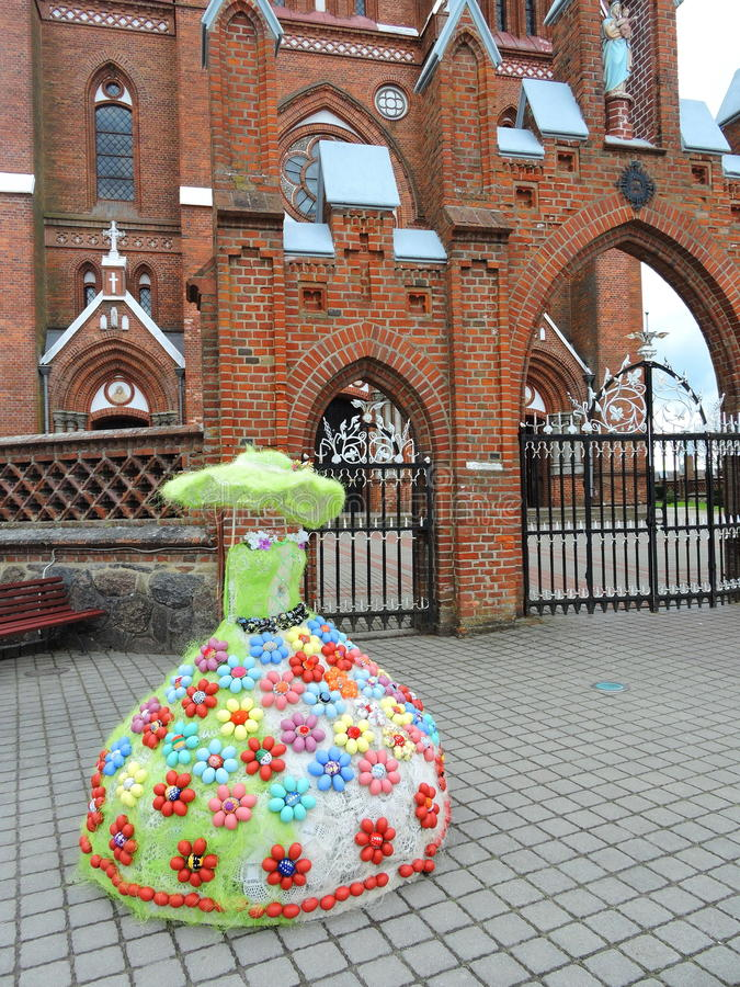 Red church and dress decorated with Easter eggs , Lithuania royalty free stock photos