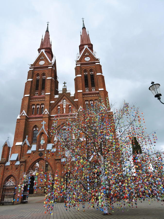Red church and Easter eggs tree, Lithuania stock images