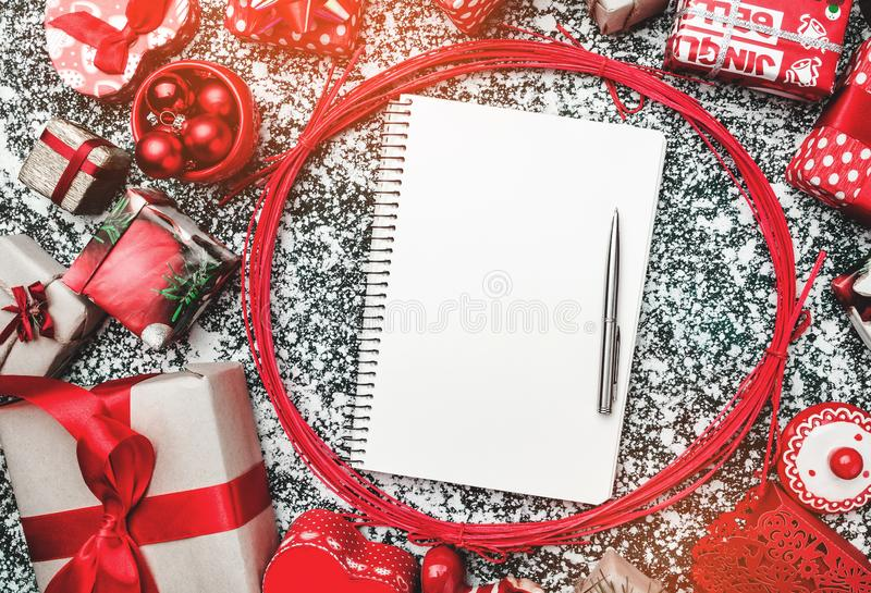 Red circle from decorative wands, with pen and notepad for text writing inside, on gray, stone, marble background. Above, top, flat view, motivational greeting stock photos