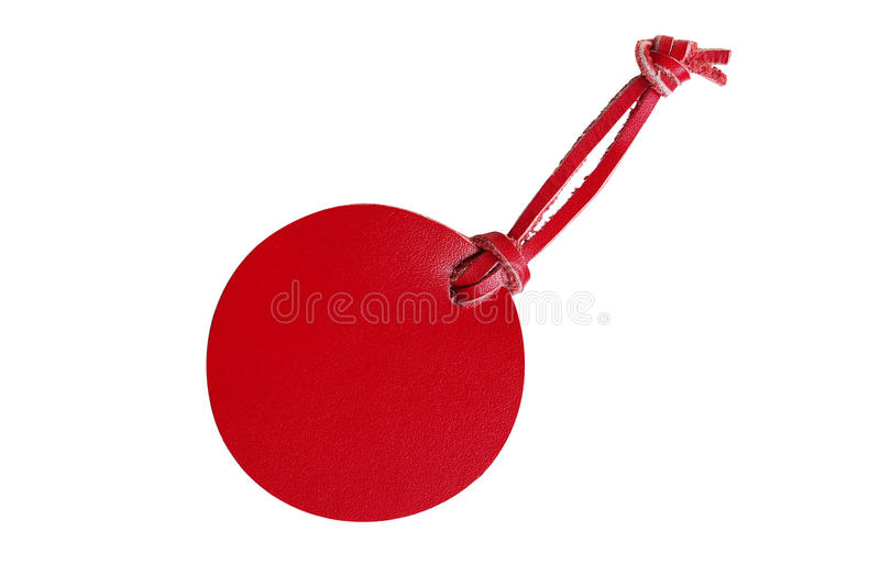 Red circle leather price tag with leather cord isolated on white. Background royalty free stock photography
