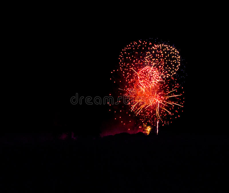 Red circles. Spectacular fireworks royalty free stock image