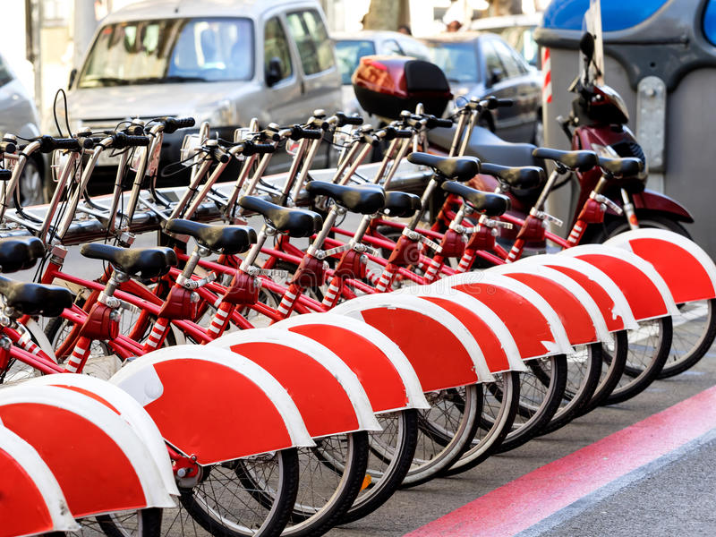 Red city bikes, bicycles in Barcelona. Spain royalty free stock image