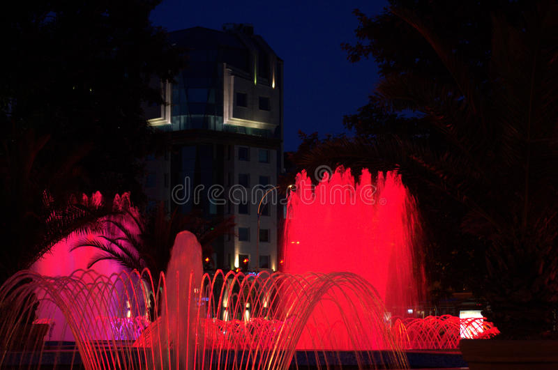 Red city fountains at night royalty free stock images