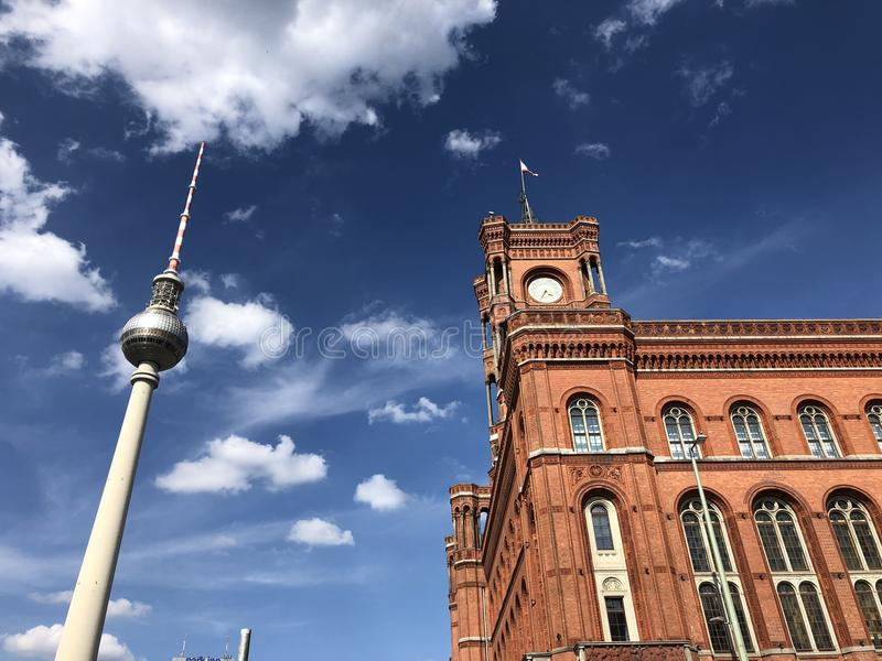 Red City Hall of Berlin, seat of the first mayor, with the television tower on Alexanderplatz. stock image