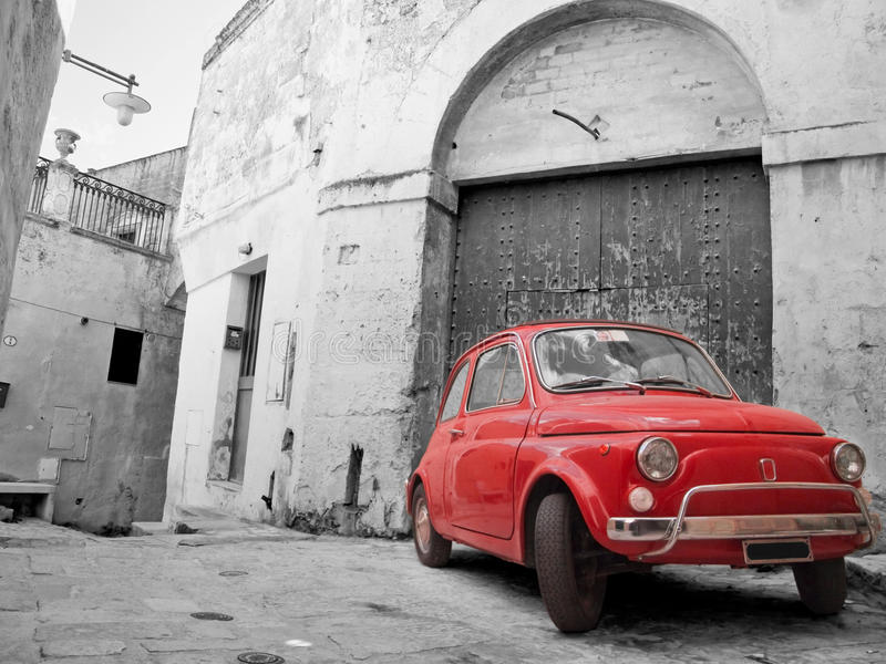 Red Classic Car. Red Classic Car in alleyway stock image