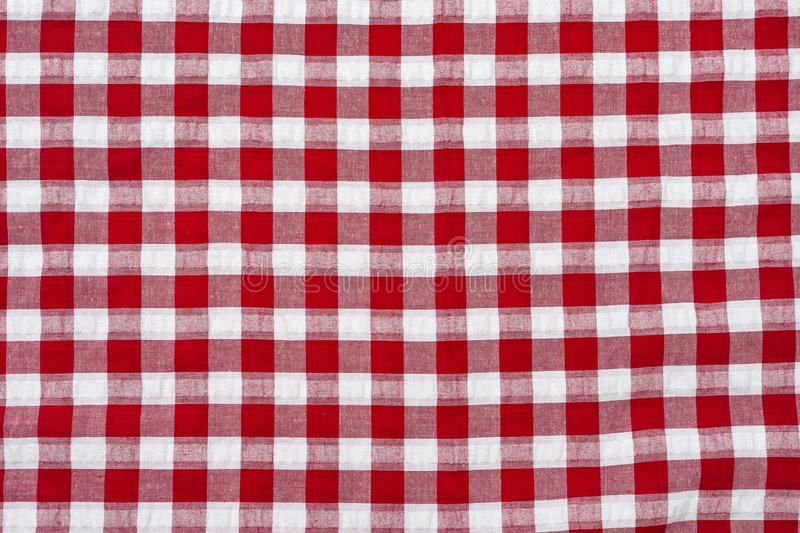 Red classic checkered tablecloth , background with copy space royalty free stock image