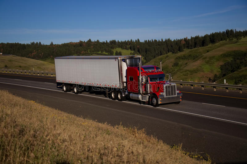 Red Classic Semi-Truck / White Trailer royalty free stock images