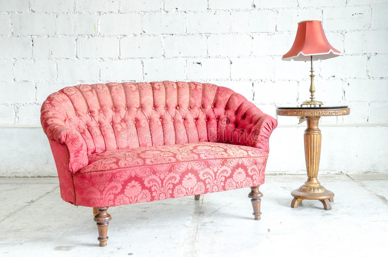 Red classical style sofa couch. In vintage room with desk royalty free stock photo