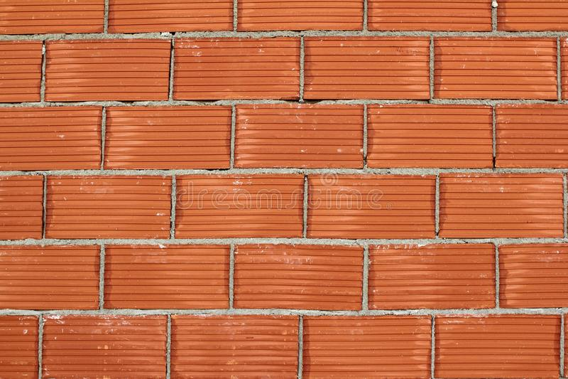 Red clay brick wall construction airbrick stock photo