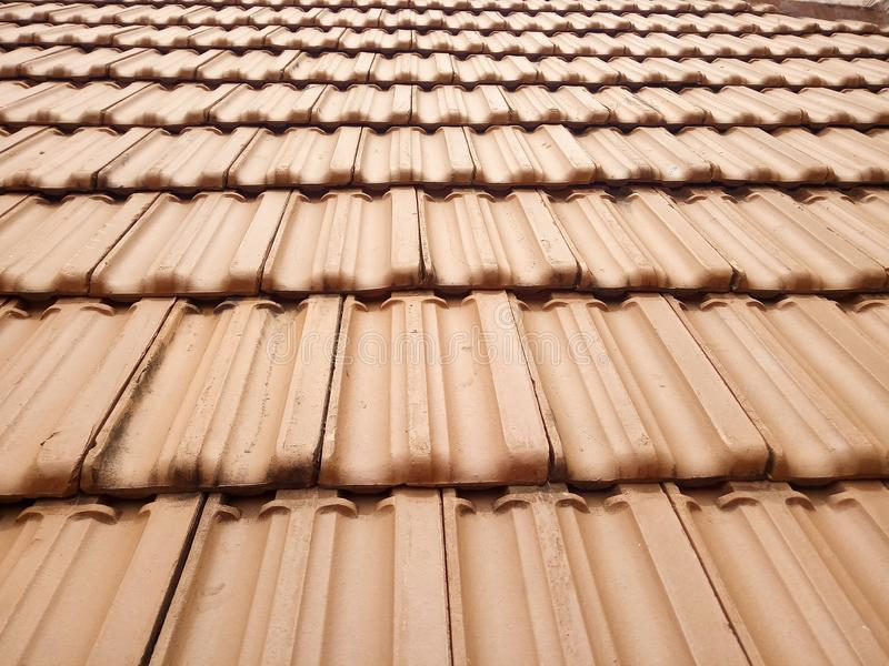 Red clay roof tiles texture pattern. View stock images