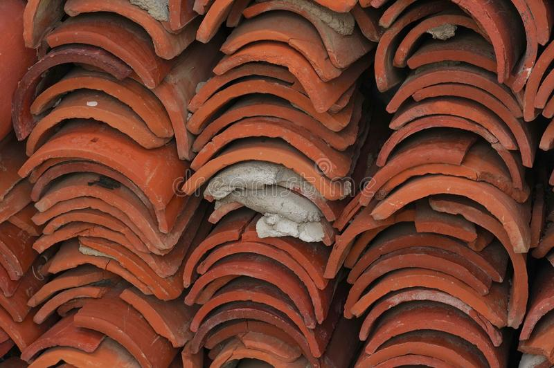 Red Clay Roofing Tiles Stacked. Red clay roof tiles stacked in an abandoned building in the Indian Canyons of Palm Springs, California royalty free stock photography