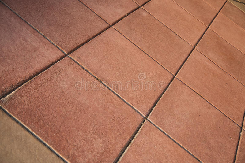 Red Clay Tile Floor. A red clay ceramic tile floor on an angle stock photography