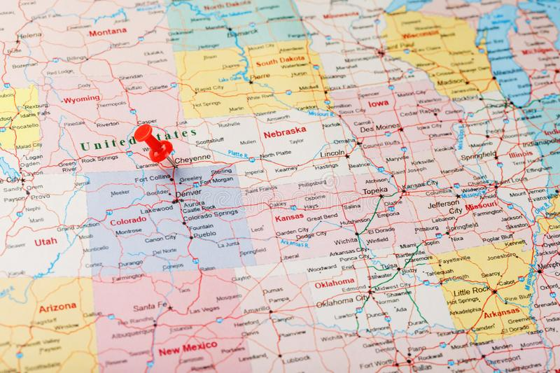 Red clerical needle on a map of United States, Wyoming and the capital Cheyenne. Close up map of wyoming with red tack, US map pin. Red clerical needle on a map royalty free stock photos