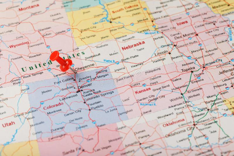 Red clerical needle on a map of United States, Wyoming and the capital Cheyenne. Close up map of wyoming with red tack, US map pin. Red clerical needle on a map stock photo