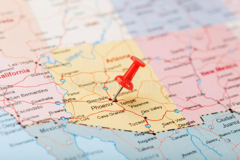 Red clerical needle on a map of the USA, Arizona and the capital Phoenix. Close up map of orizona with red tack stock photography