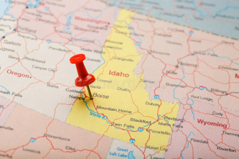 Red clerical needle on a map of USA, Idaho and the capital Boise. Closeup Map Idaho with Red Tack stock image