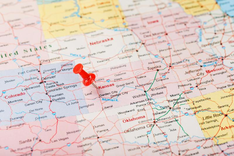 Red clerical needle on a map of USA, Kansas and the capital Topeka. Close up map of Kansas with red tack. United States map pin USA royalty free stock photo