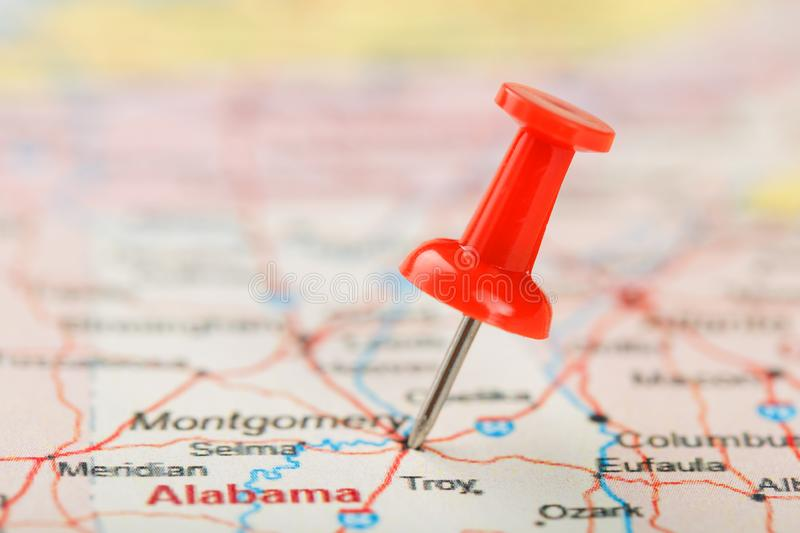 Red clerical needle on a map of USA, South Alabama and the capital Montgomery. Close up map of South Alabama with red tack royalty free stock photography