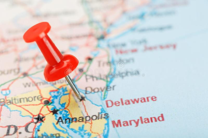 Red clerical needle on a map of USA, South Delaware and the capital Dover. Close up map of Delaware Carolina with red tack. United States map pin USA stock images