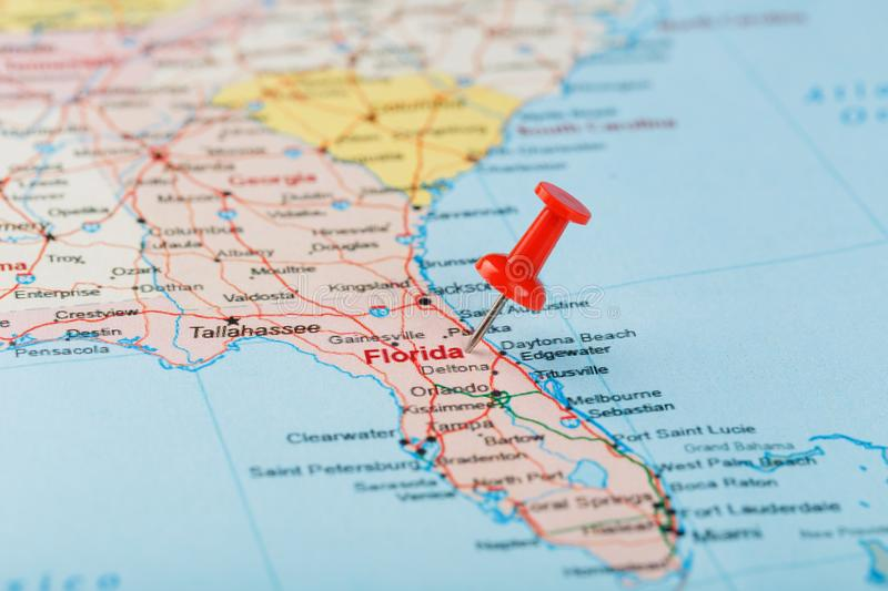 Red clerical needle on a map of USA, South Florida and the capital Tallahassee. Close up map of South Florida with red tack. United States map pin USA royalty free stock photo