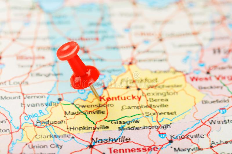 Red clerical needle on a map of USA, South Kentucky and the capital Frankfort. Close up map of South Kentucky with red tack. United States map pin USA royalty free stock images