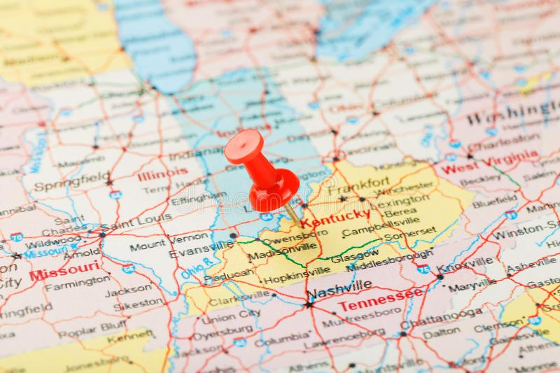 Red clerical needle on a map of USA, South Kentucky and the capital Frankfort. Close up map of South Kentucky with red tack. United States map pin USA stock image