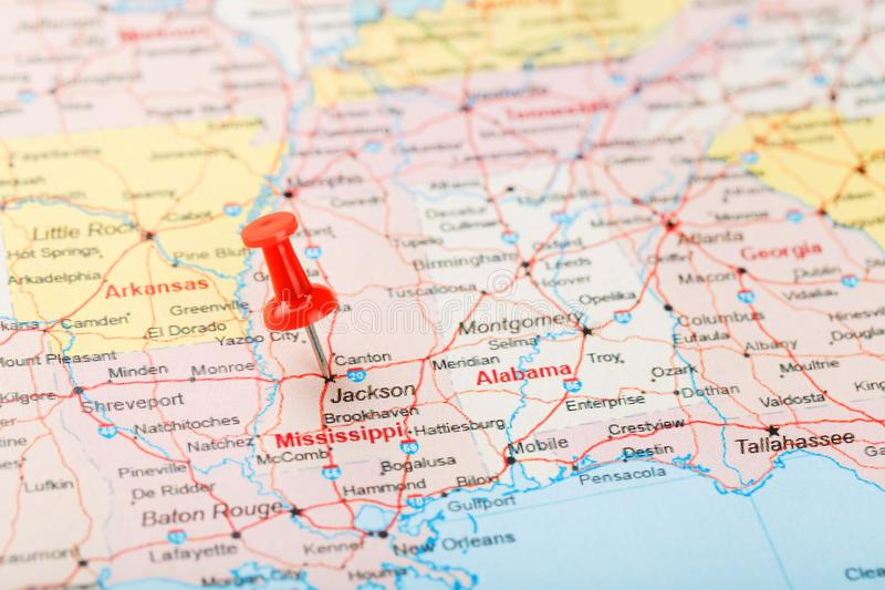 Red clerical needle on a map of USA, South Mississippi and the capital Jackson. Close up map of South Mississippi with red tack stock photo