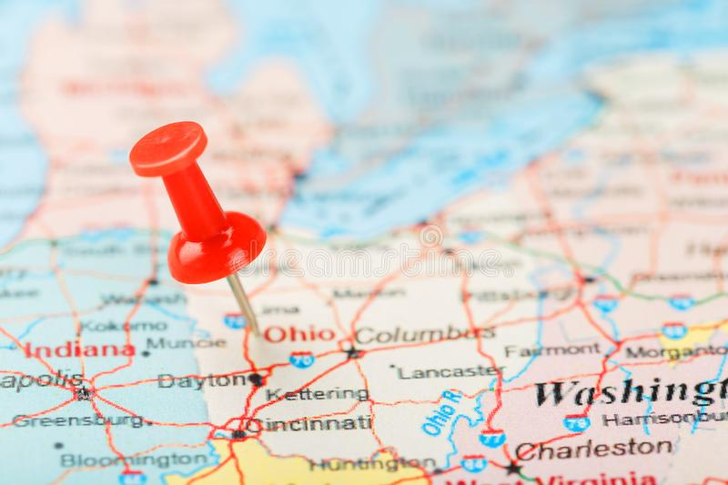 Red clerical needle on a map of USA, South Ohio and the capital Columbus. Close up map of South Ohio with red tack royalty free stock images