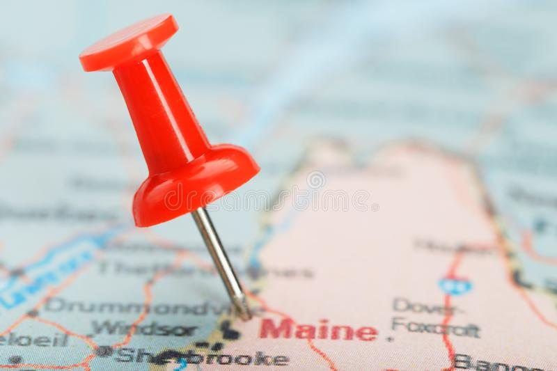 Red clerical needle on a map of USA, South South Maine and the capital Augusta. Close up map of South South Maine with red tack. United States map pin USA royalty free stock image