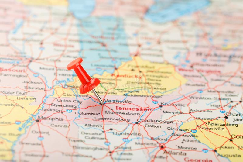 Red clerical needle on a map of USA, South Tennessee and the capital Nashville. Close up map of South Tennessee with red tack stock images