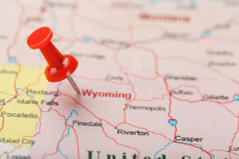 Red clerical needle on a map of USA, Wyoming and the capital Cheyenne. Close up map of wyoming with red tack. US map pin royalty free stock photo