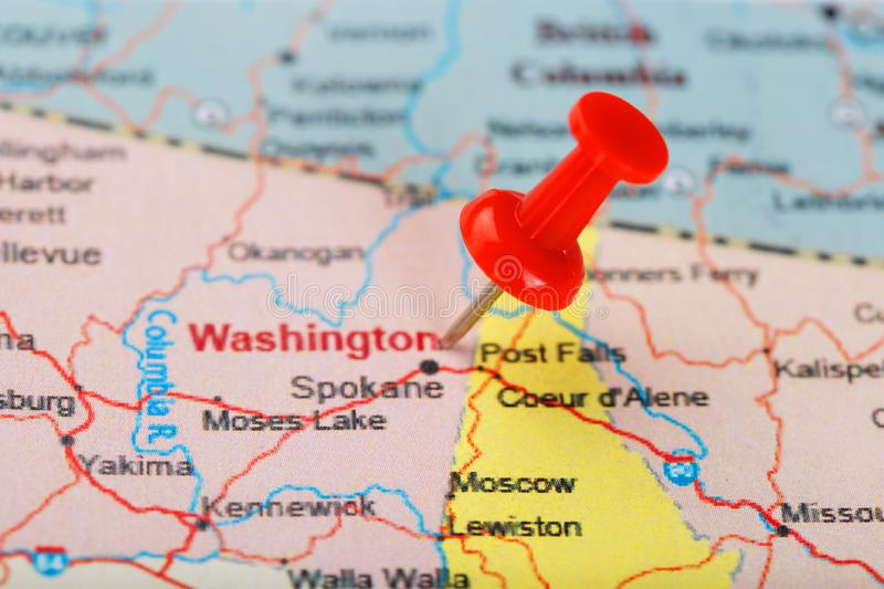 Red clerical needle on a map of USA, Wyoming and the capital Cheyenne. Close up map of wyoming with red tack. US map pin royalty free stock images