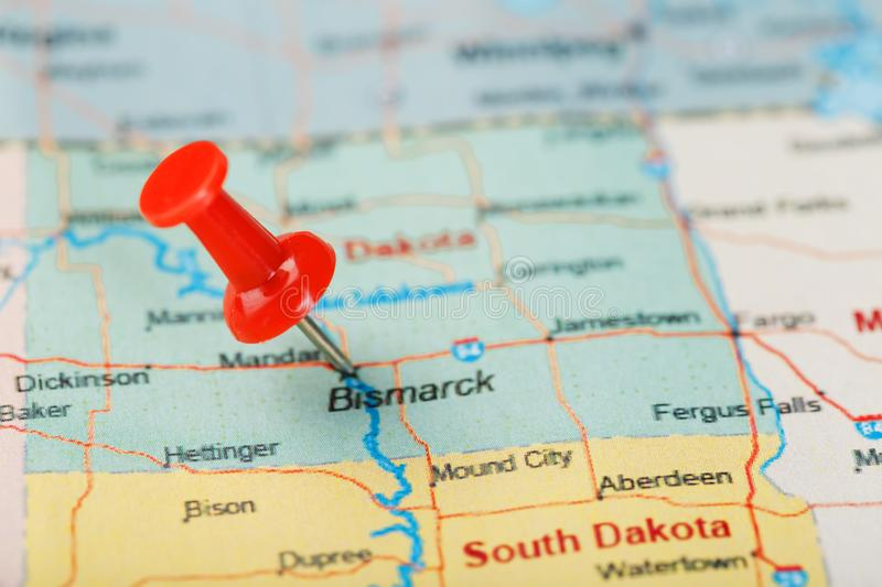Red clerical needle on a map of USA, North Dakota and the capital Bismarck. Closeup Map North Dakota with Red Tack. United States. Red clerical needle on a map royalty free stock photography